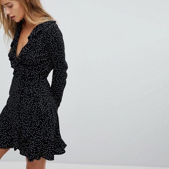 d05129dc60a ASOS Dresses   Skirts - Nobody s Child long sleeve ruffle wrap dress ASOS